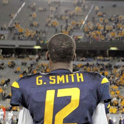 Geno Smith and West Virginia will try to put two blowout losses behind them when they play host to TCU Saturday.