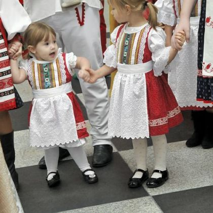 Lizzie Lipchick, 2, left, and Marissa Ann Tilger, 4, appear with the rest of the Pittsburgh Area Slovak Folk Ensemble Thursday during an announcement about Light Up Night.