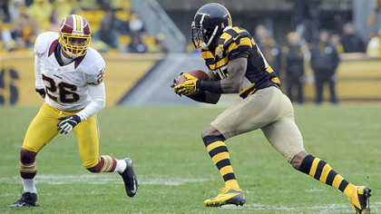 Steelers receiver Mike Wallace pulls in a pass against Redskins&#039; Josh Wilson in the fourth quarter last Sunday at Heinz Field.