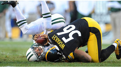 Steelers linebacker LaMarr Woodley sacks New York Jets quarterback Mark Sanchez during a game in September.