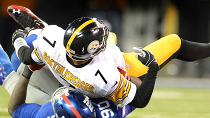The Giants&#039; Justin Tuck sacks Steelers quarterback Ben Roethlisberger.