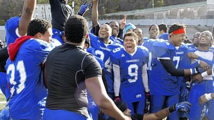 The Perry High School football team celebrates after winning the City League football championship at Cupples Stadium on Saturday.