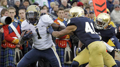 Pitt running back Ray Graham, left, breaks the tackle of Notre Dame safety Matthias Farley to score a touchdown during the first half.