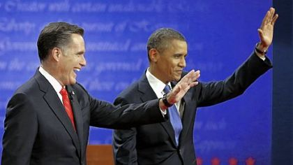 Republican presidential nominee Mitt Romney and President Barack Obama wave to the audience during the first presidential debate at the University of Denver.