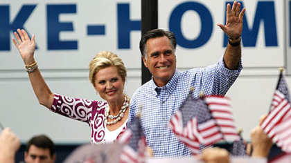 Mitt Romney waves as he arrives with his wife Ann at a campaign rally Oct. 7 in Port St. Lucie, Fla.