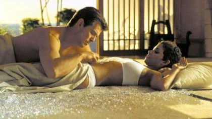 "Pierce Brosnan as James Bond with Jinx, played by Halle Berry in ""Die Another Day"""