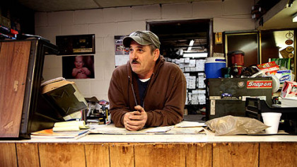 Keith Wickham, of Zanesville, Ohio, works at the Muffler Shop in Zanesville. He hasn't been to the polls since 1996, when he voted for Ross Perot.