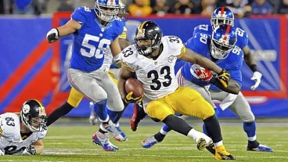 Isaac Redman carries against the Giants in the fourth quarter Sunday at MetLife Stadium in East Rutherford, N.J. Redman ran for 147 yards on 26 carries with one touchdown.