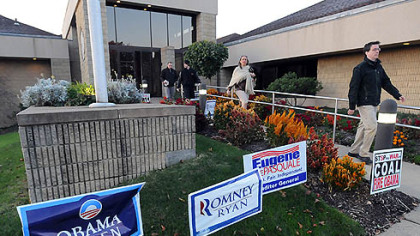 Early voters stream out of the Green Tree Municipal Building after casting their ballots early today.