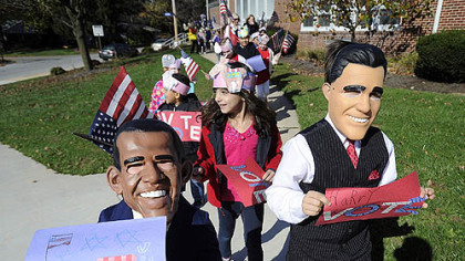 Second-graders Brayden Gentzyel, left, as President Obama and Harry Perkins, right, dressed as Mitt Romney, from Valley View Elementary School in the York Suburban School District in York, Pa., lead a parade of students around the school to encourage people to vote.