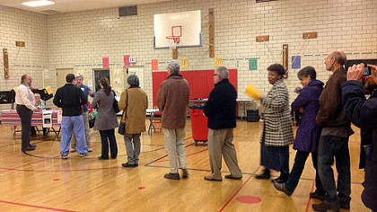 The first voters enter the poll at 7 a.m. at Linden Academy, Point Breeze.