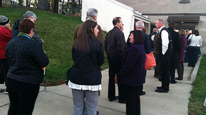 Voters stand in line at 7 a.m. to enter the poll at Christ Episcopal Church in Ross.