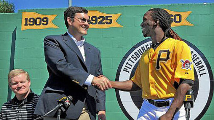Pirates owner Bob Nutting and Andrew McCutchen shake hands at the news conference in Bradenton, Fla. this spring, announcing McCutchen's $51.5 million, six-year contract.