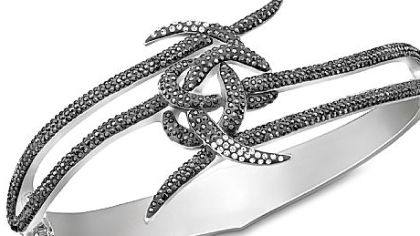 "The Bond love knot bangle, featured in the new movie ""Skyfall,"" is $270 at www.swarovski.com and Swarovski locations."