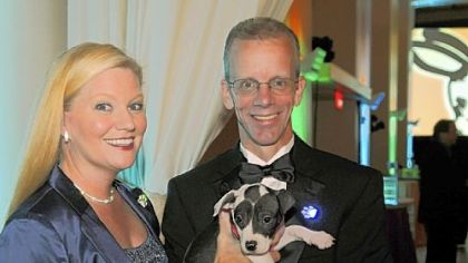 Patty and David Swisher, president and CEO of Animal Friends with Summer.