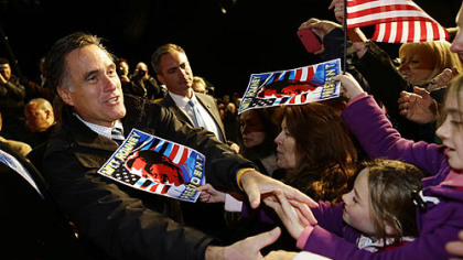 Republican presidential candidate Mitt Romney greets supporters Sunday at a Virginia campaign rally at Newport News International Airport, in Newport News, Va.