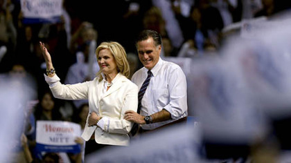 Republican presidential candidate, former Massachusetts Gov. Mitt Romney takes the stage with wife Ann before speaking at a campaign event at the Verizon Wireless Arena, in Manchester, N.H.