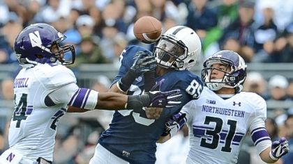 Brandon Moseby-Felder, middle, attempts to zero in on a pass against Northwestern earlier this season. Moseby-Felder is third among Penn State receivers with 25 catches this season.