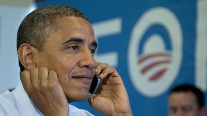 President Barack Obama calls Wisconsin volunteers as he visits a campaign office call center today.