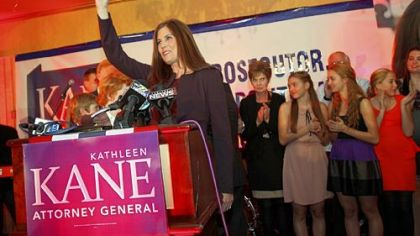 Kathleen Kane smiles at the media after voting at a polling place Tuesday in the Waverly Community House, in Waverly, Pa.