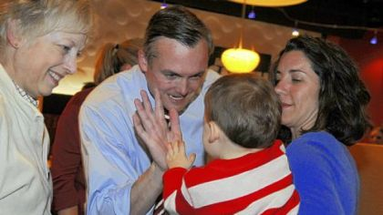 Democrat Matt Smith celebrates Tuesday night with son Jameson, 1, as his wife Eileen, right, and his mother, Janise Smith, look on at the Walnut Grille in Mt. Lebanon. Mr. Smith defeated Republican D. Raja for state Senate.