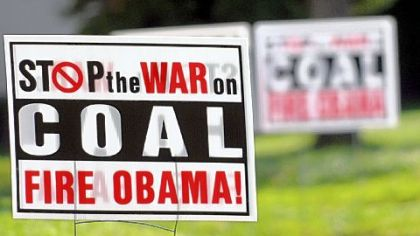 Signs in Waynesburg attack the president and his coal policies.