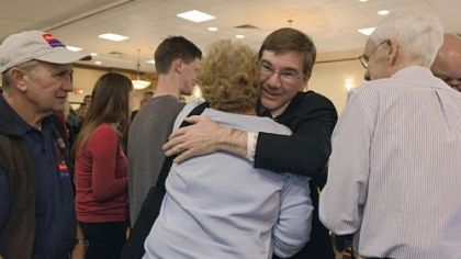 Republican Keith Rothfus, left, hugs a supporter Tuesday night at the Holiday Inn in Ross after winning his congressional seat.