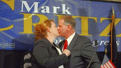 Rep. Mark Critz kisses his wife, Nancy, Tuesday after conceding his re-election bid to challenger Keith Rothfus at the Holiday Inn in Johnstown.
