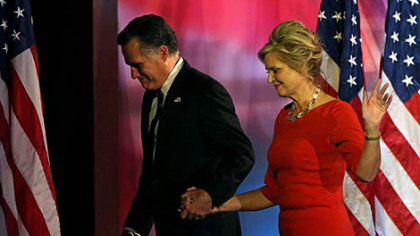 Republican presidential candidate Mitt Romney and his wife, Ann, walk off of the stage after conceding the presidency during Mitt Romney's election night event at the Boston Convention & Exhibition Center in Boston, Mass.