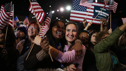 Supporters of President Barack Obama cheer after networks project Obama for re-election during the Obama Election Night watch party at McCormick Place in Chicago, Illinois.