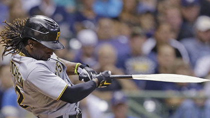 Andrew McCutchen breaks his bat during his RBI single against the Milwaukee Brewers.