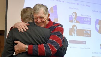 Republican Keith Rothfus, left, hugs his father, Earl, Tuesday night at the Holiday Inn in Ross after winning a congressional seat.