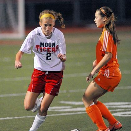 Moon Area's Michaela Guttierrez tries to maneuver around Yough's Mikayla Mance during a WPIAL quarterfinal match.