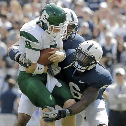 Penn State linebackers Gerald Hodges and Khairi Fortt tackle Eastern Michigan quarterback Alex Gillett  during the second quarter of a NCAA college football game in State College, Pa.