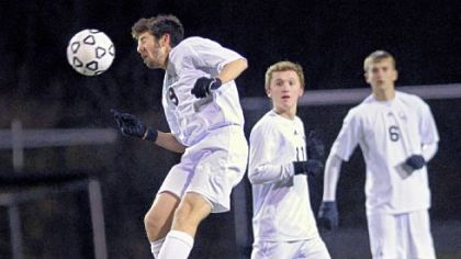 Quaker Valley's Dante Piccolo heads the ball from midfield against General McLane Tuesday.