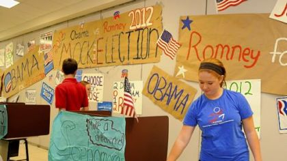 Madison Zimmer, a sophomore at Chartiers Valley High School, casts her vote in the school's mock presidential election. David Harhai's Advanced Placement U.S. Government and Politics class organized the election.