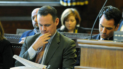 Mayor Luke Ravenstahl prepares before making remarks at a hearing in city council chambers.