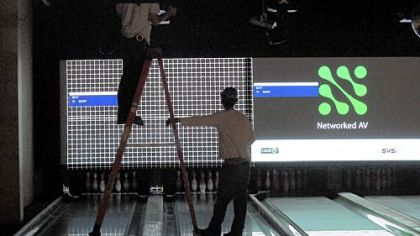 Construction workers install equipment in the bowling lanes at Latitude 40 in North Fayette.