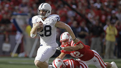 Penn State's Zach Zwinak runs for a touchdown past Nebraska's Sean Fisher (42) and Alonzo Whaley (45) in the first half.