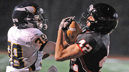 Central Catholic cornerback Joe Tindal, left, battles for the ball with Upper St. Clair receiver Tim Witenske in the first half of the WPIAL quarterfinal Friday at Baldwin High School.