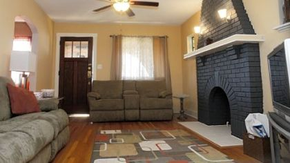 The living room at the home at 1509 Wareman Ave., Brookline, whch is on the market for $139,900.