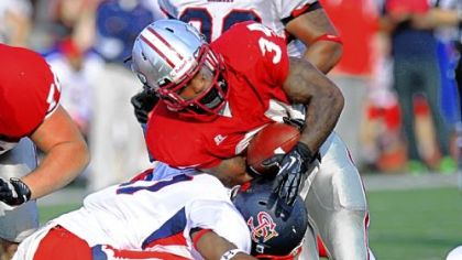 IUP's De'Antwan Williams is tackled by a Shippensburg defender during the PSAC championship in Indiana, Pa.