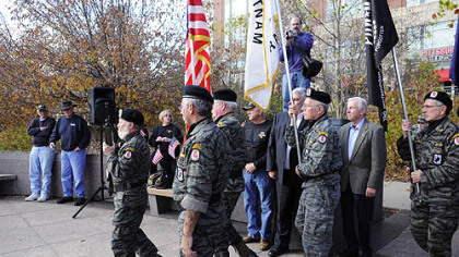 The Vietnam Veterans Inc. Honor Guard takes part in a ceremony honoring Vietnam veterans and the 25th anniversary of the Vietnam Veterans Monument on the North Shore.
