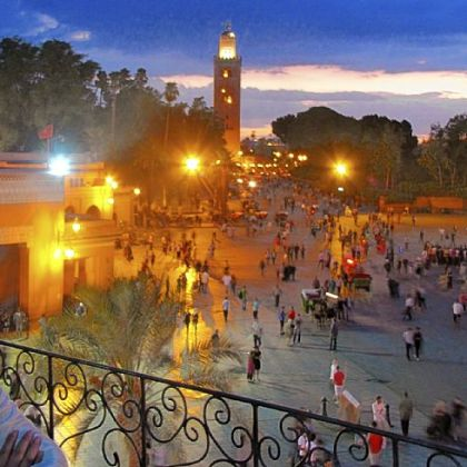 Jemaa el Fna with Koutoubia Mosque at sunset.