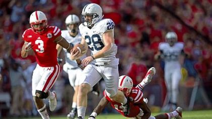 Penn State's Zach Zwinak (28) breaks free from Nebraska defenders Saturday in Lincoln, Neb.