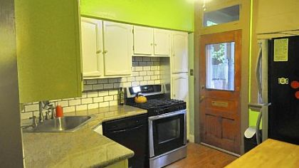 The kitchen features granite countertops, a tile backsplash and stainless-steel appliances.