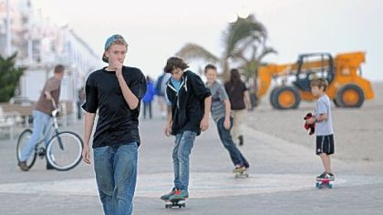 Skateboarders make their ways Sunday along the boardwalk in Ocean City, Md., as beach restoration continues after Superstorm Sandy.