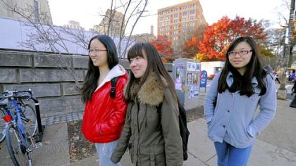 International students Ellen Hu, 23, Maggie Lin, 23, and Lauren Su, 20, right, walk to class at the University of Pittsburgh.