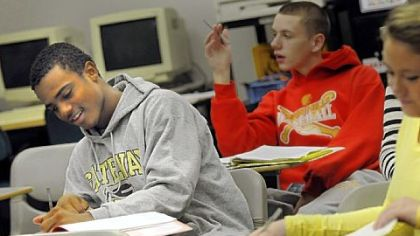 Delvon Randall, a junior at Boyce Campus Middle College High School, takes notes during class.