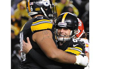 Steelers kicker Shaun Suisham celebrates with tackle Mike Adams after kicking the game-winning field goal against the Chiefs in overtime.